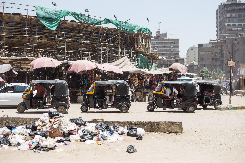 Tuk tuk drivers queue for passengers in Mohandiseen, Cairo. May 1, 2014