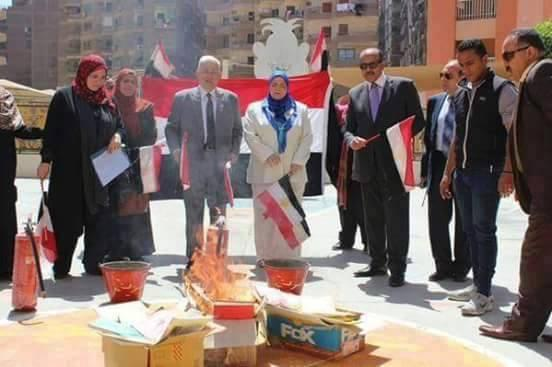 Education Ministry officials burn books