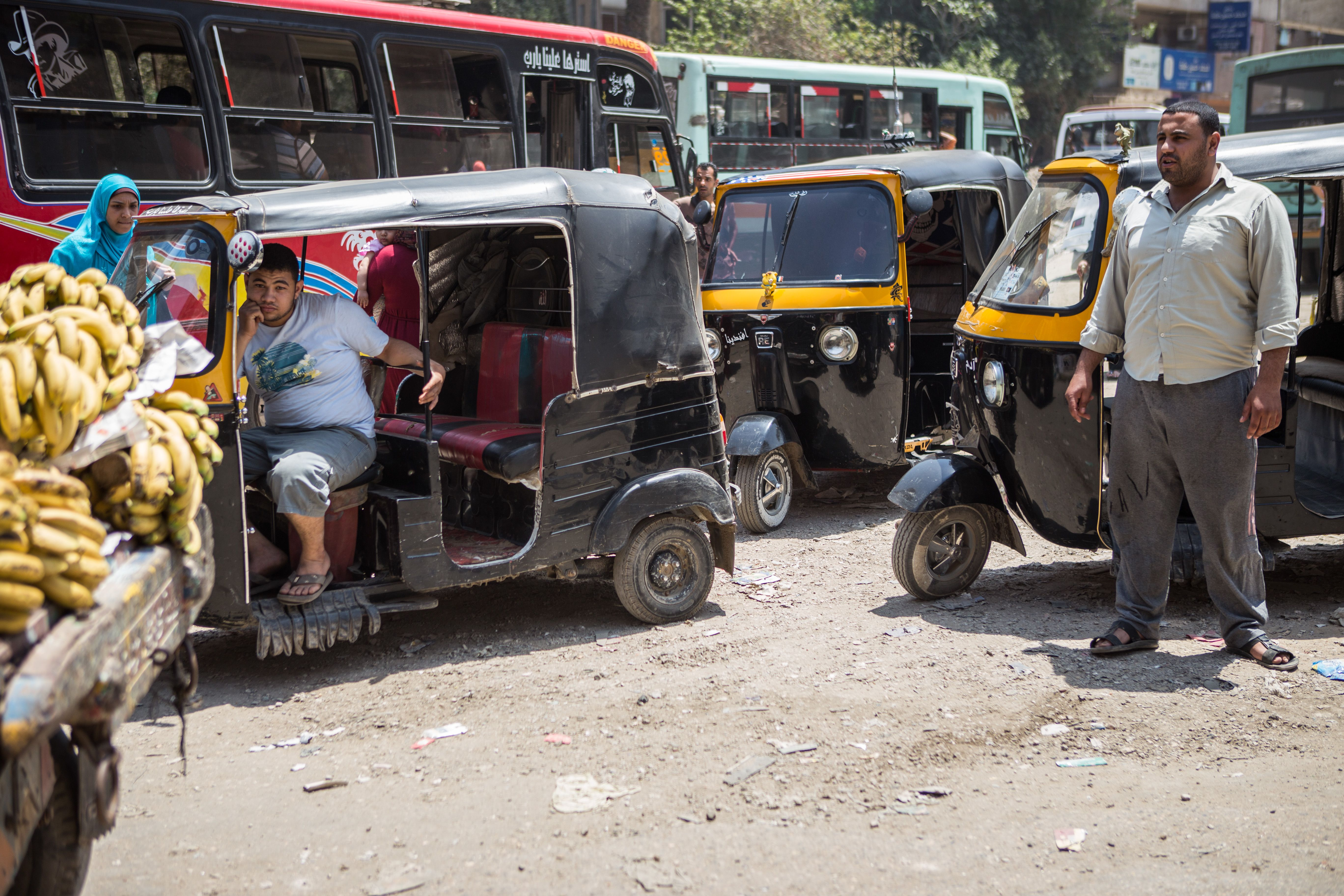 Tuk tuks, buses, cars and pedestrians compete for space on busy streets. May 1, 2014