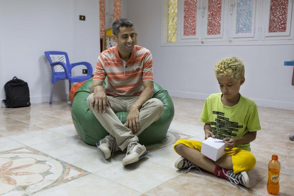 Hani al-Gamal and his son Karim, who is making an origami box – Sabaa Sanaye Center, Maadi.