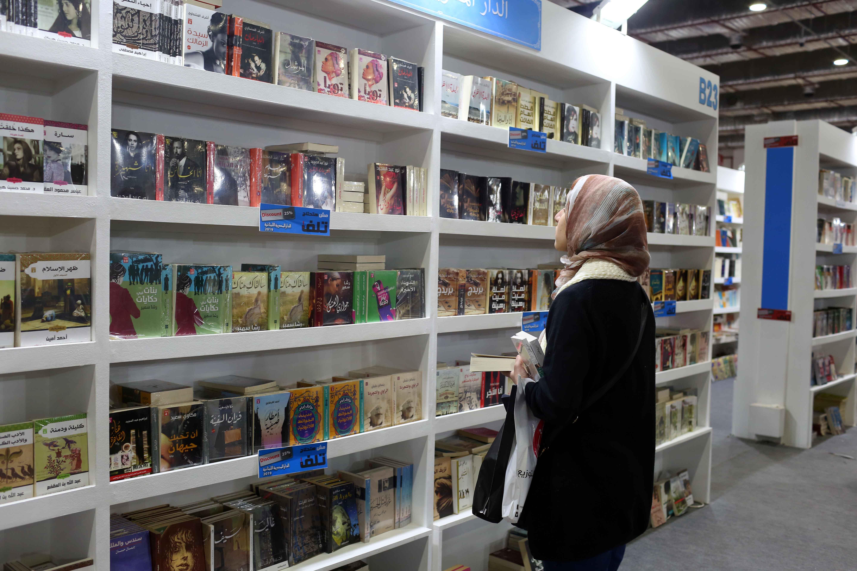 woman looking at bookshelves